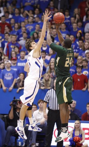 Kansas center Jeff Withey extends to defend against a shot from South Florida forward Augustus Gilchrist during the second half on Saturday, Dec. 3, 2011 at Allen Fieldhouse.