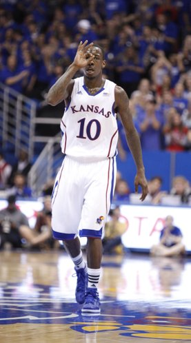 Kansas guard Tyshawn Taylor signals to the bench after hitting a three-pointer against South Florida during the second half on Saturday, Dec. 3, 2011 at Allen Fieldhouse.