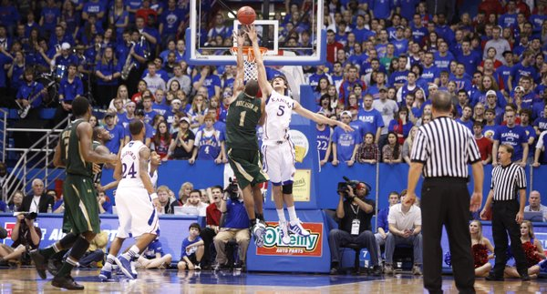 Kansas center Jeff Withey defends against a shot by South Florida forward Ron Anderson Jr. during the second half on Saturday, Dec. 3, 2011 at Allen Fieldhouse.