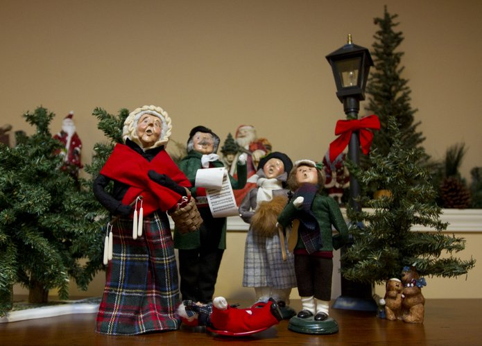 figurines such as these christmas carolers lined the home of steve and lori myrick