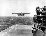In this April 18, 1942 file photo, one of Lt. Col. Jimmy Doolittle's B-25 bombers takes off from the flight deck of the USS Hornet for the initial air raid on Tokyo. Coming just four months after the Imperial Japanese Navy savaged the U.S. Pacific Fleet at Pearl Harbor, the Doolittle raid on Japan's home did little damage, but lifted the spirits of Americans and electrified a world at war. (AP Photo, File)