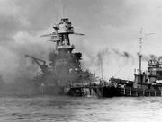 The U.S.S. Nevada burns after being attacked on Dec. 7, 1941. Lawrence resident Vincent Muirhead served on the Nevada that day.