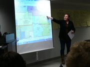 "Dawn Shew, a member of the Central and East Lawrence Elementary School Consolidation Working Group, points out a potential new boundary — which would be Ninth Street to the North — for a new school that would combine the bulk of Kennedy and New York schools at a site near the former home of East Heights School. Shew made the presentation during the Monday, Dec. 5, 2011 meeting of the working group, advocating for a new school. ""If we are going to be consolidated, this would be ideal for us,"" she said."
