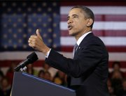 President Barack Obama gestures while speaking about the economy, Tuesday, Dec. 6, 2011, at Osawatomie High School in Osawatomie, Kan.