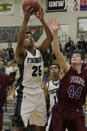 Senior Gabe Patterson (25) grabs the rebound for Free State against Topeka Seaman on Tuesday, Dec. 6, 2011 at FSHS.