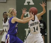 Free State's Lynn Robinson (14) defends against Topeka Seaman on Tuesday, Dec. 6, 2011 at FSHS.