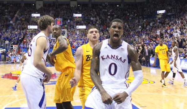 Kansas forward Thomas Robinson celebrates for the television cameras after a put-back dunk against Long Beach State during the second half Tuesday, Dec. 6, 2011 at Allen Fieldhouse.