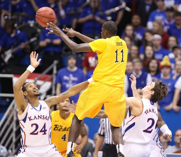 Kansas guards Travis Releford (24) and Conner Teahan (2) defend against a pass from Long Beach State forward James Ennis during the second half on Tuesday, Dec. 6, 2011 at Allen Fieldhouse.