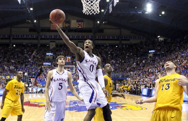 Kansas forward Thomas Robinson heads in to the bucket against the Long Beach State defense during the second half on Tuesday, Dec. 6, 2011 at Allen Fieldhouse.