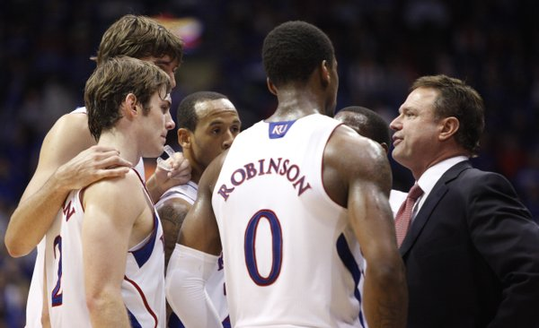 The Jayhawks huddle around head coach Bill Self late in the game against  Long Beach State on Tuesday, Dec. 6, 2011 at Allen Fieldhouse.