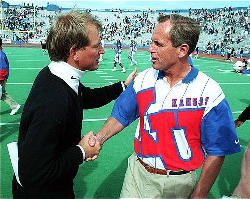 Former Colorado and Washington football coach Rick Neuheisel, left, and former KU coach Glen Mason, who went 47-54-1 from 1988-1996.