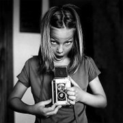 Now that digital photography has replaced film and children are using electronic devices at younger ages, a digital camera could be a good gift for a budding photographer. Cameras built to take abuse are a good choice for young shutterbugs, many less-expensive, point-and-shoot models could serve a young child and their family with photo opportunities.