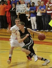 Free State's Tyler Self drives the baseline against Shawnee Heights on Friday, Dec. 9, 2011 in Topeka.