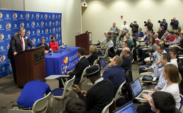 Charlie Weis addresses media members alongside Kansas University athletic director Sheahon Zenger and Chancellor Bernadette Gray-Little during a news conference on Friday, Dec. 9, 2011, at the Anderson Family Football Complex.