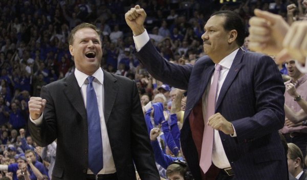 KU coach Bill Self and assistant coach Kurtis Townsen react to a basket by Thomas Robinson who also drew a foul on the play, during the second-half of the Jayhawks 78-67 win over #2 nationally ranked Ohio State University at Allen Fieldhouse, Dec. 10, 2011. ..