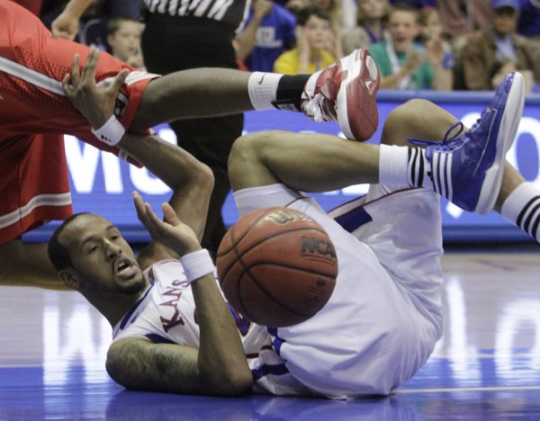 Travis Releford (24) lands on the floor during a loose ball scramble during the first-half of the Jayhawks game against #2 nationally ranked Ohio State University at Allen Field House, Dec. 10, 2011. ..