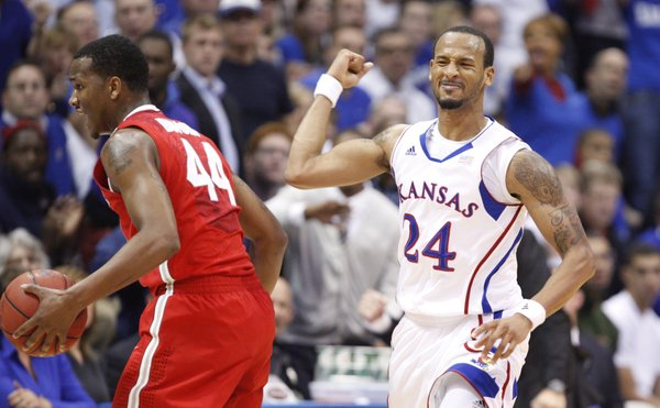 Kansas guard Travis Releford pumps his fist after forcing Ohio State guard William Buford to turn it over in the first half Saturday, Dec. 10, 2011 at Allen Fieldhouse.