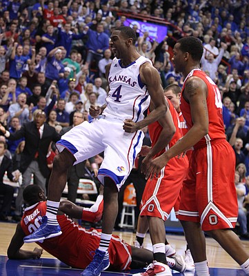 Kansas forward Justin Wesley celebrates a dunk against Ohio State during the first half Saturday, Dec. 10, 2011 at Allen Fieldhouse.