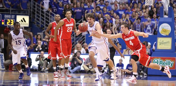 Kansas center Jeff Withey knocks away a pass intended for Ohio State guard Aaron Craft during the first half Saturday, Dec. 10, 2011 at Allen Fieldhouse.