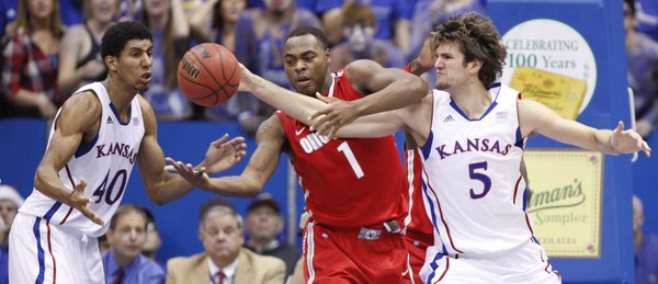 Kansas center Jeff Withey (5) and forward Kevin Young (40) battle for a loose ball with Ohio State forward Deshaun Thomas during the second half on Saturday, Dec. 10, 2011 at Allen Fieldhouse.