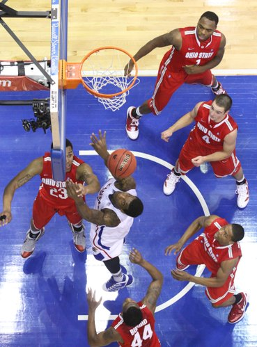 Kansas forward Thomas Robinson fights for an offensive rebound against the Ohio State defense during the second half on Saturday, Dec. 10, 2011 at Allen Fieldhouse.