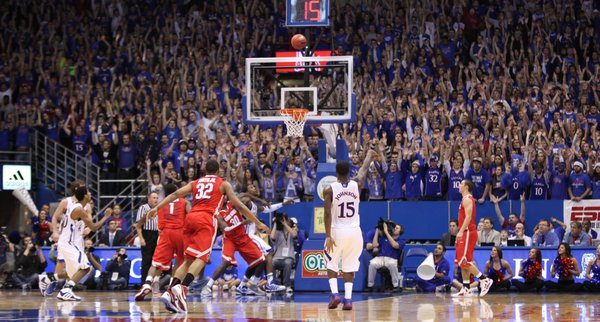 Kansas guard Elijah Johnson falls backward as he watches one of his five three-pointers go down against Ohio State during the second half on Saturday, Dec. 10, 2011 at Allen Fieldhouse.