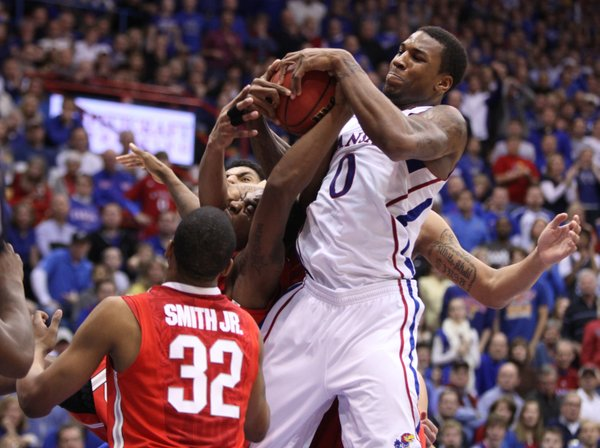 Kansas forward Thomas Robinson rips away a rebound from the Ohio State players during the second half on Saturday, Dec. 10, 2011 at Allen Fieldhouse.