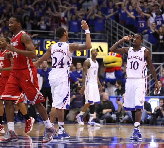 Kansas guards Tyshawn Taylor (10) and Travis Releford (24) high five as the Jayhawks wrap up the game against Ohio State with seconds remaining in regulation.