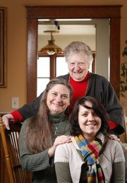 Debra Jennings, middle, a professional braider, is pictured with her mother, Lorene Davison and her daughter, Cody Jennings on Monday, Dec. 12, 2011. Jennings learned to braid from her mother and now works with her daughter braiding hair at Renaissance festivals, parties and weddings.
