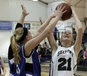 Bishop Seabury's Reilly Malone (21) tries for two on Monday, Dec. 12, 2011, during girls basketball action at Bishop Seabury. Seabury defeated KSD, 46-16.
