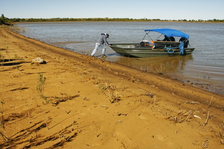 "In this 2007, file photo Frank ""Jerry"" deNoyelles, KU ecology professor of the Kansas Biological Survey, launches a boat off the banks of Kanopolis Lake southwest of Salina. DeNoyelles is part of a team of researchers that is measuring the silt filling up Kansas reservoirs."