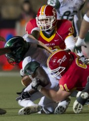 Former Lawrence High wide receiver, and current Pittsburg State safety, Jared Vinoverski (31) tackles a Lincoln player on Oct. 15 at Pitt State.