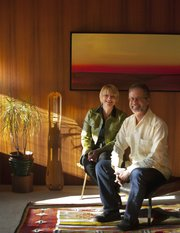 Lawrence residents Tom Harper and Terri Erickson-Harper are pictured Dec. 9 in their Lawrence home that was built in 1952 and designed by John C. Morley. A defining feature throughout the majority of the home are the Philippine mahogany walls. Harper is one of the founding members of the Lawrence Modern group.