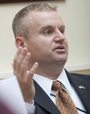 SRS Secretary Rob Siedlecki spoke with Lawrence Journal-World editors and reporters in this file photo from Monday, July 11, 2011. Siedlecki will be returning to Florida to take a state government position there and be closer to his family, Gov. Sam Brownback's office said Thursday.