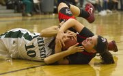 Free State's Jackie Garcia (10) and Lawrence High's Anna Wright wrestle for control of the ball Friday, Dec. 16, 2011 at FSHS.