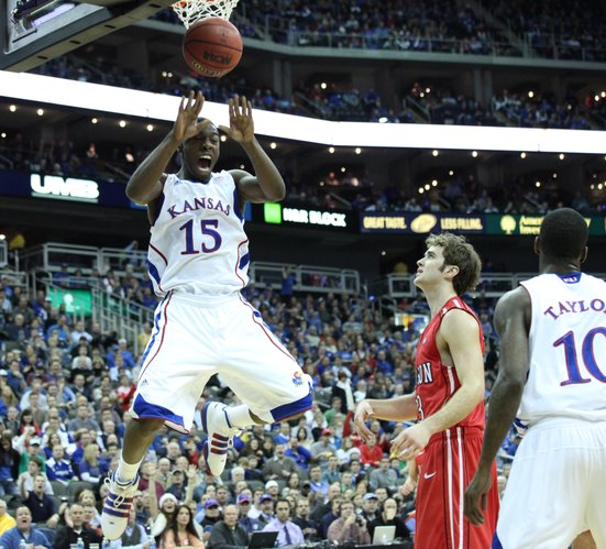 Kansas guard Elijah Johnson dunks on Davidson in the first half Monday, Dec. 19, 2011 at Sprint Center in Kansas City, Mo.