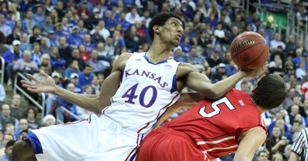 Kansas forward Kevin Young grabs the ball off the back of Davidson's JP Kuhlman (5) in the first half Monday, Dec. 19, 2011 at Sprint Center in Kansas City, Mo.