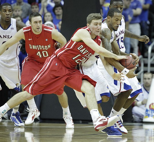 Kansas guard Travis Releford steals from Davidson's Nik Cochran (12) in the second half Monday, Dec. 19, 2011 at Sprint Center in Kansas City, Mo.