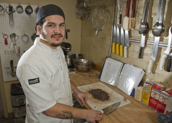 "Hank Charcuterie chef de cuisine Juan Carlos 'Jay' Tovar-Ballagh, pictured in this 2011 Journal-World photo at the former Pachamamas kitchen, died last November at 27, leaving behind several notebooks of recipe ideas. ""Jay's Dinner,"" a six-course meal inspired by his notes, will take place Thursday at Sarah's Upstairs, 927 1/2 Massachusetts St., benefitting Just Food."