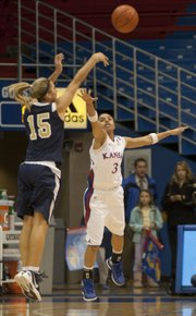 Oral Roberts' Kevi Luper  (15) fires a three over the outstretched arm of Angel Goodrich during Kansas' game against Oral Roberts Wednesday, Dec. 21, 2011 in Allen Fieldhouse.