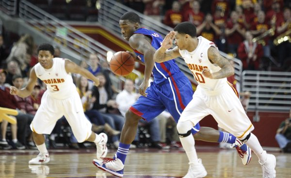 Kansas guard Elijah Johnson moves the ball up the court between USC players Maurice Jones (10) and Alexis Moore (3) after a steal during the first half Thursday, Dec. 22, 2011 at the Galen Center in Los Angeles, Calif.