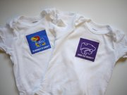 Onesie fronts — the Jayhawk has a Powercat on the back and vice versa.