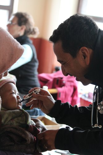 Dr. Sidhartha Gurung, a general practitioner from California, checks the vital signs of a baby during a free medical clinic in the Mustang district of Nepal. He was among 42 volunteers who spent four days providing care for poor, rural residents.