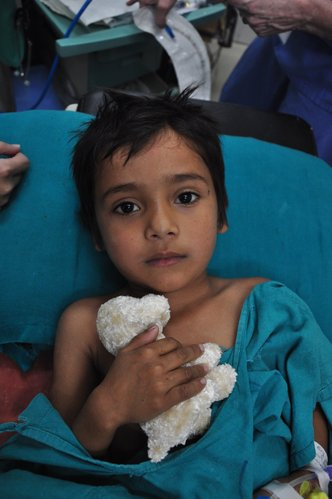 A 5-year-old boy from a village near Pokhara, Nepal, awaits to receive free medical care by the surgical team.