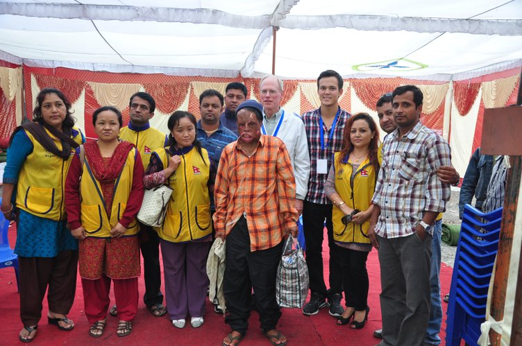 Dr. Bill Dixon, of Lawrence, fifth from right in back row, poses for a picture during a medical mission trip in Nepal in early November. Dixon is an internal medicine doctor at Watkins Health Center at Kansas University. On Dixon's right is Brandon Cusick, assistant mission director for the Pokhara surgical team. They are pictured with Lions Club of Pokhara Aangan volunteers who are in yellow vests. They provided free medical care for the patient in front.