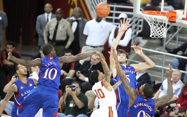 The Kansas defense hovers around USC guard Maurice Jones on a shot during the second half on Thursday, Dec. 22, 2011 at the Galen Center.