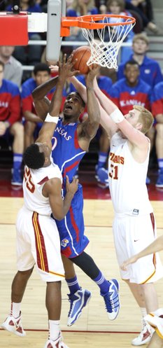 Kansas forward Thomas Robinson fights inside for a shot against USC defenders Byron Wesley (25) and James Blasczyk (31) during the second half on Thursday, Dec. 22, 2011 at the Galen Center.