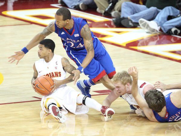 Kansas guard Travis Releford pressures USC guard Maurice Jones as KU center Jeff Withey and USC center James Blasczyk hit the floor during the second half on Thursday, Dec. 22, 2011 at the Galen Center.