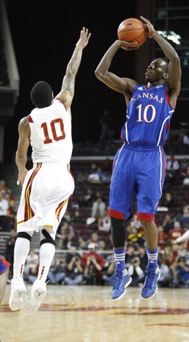 Kansas guard Tyshawn Taylor pulls up for a jumper over USC guard Maurice Jones during the first half on Thursday, Dec. 22, 2011 at the Galen Center.