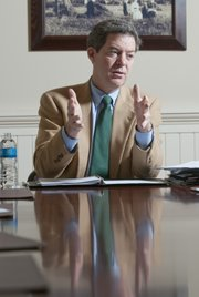 Gov. Sam Brownback, pictured in January 2012, speaking to reporters and editors at the Lawrence Journal-World.